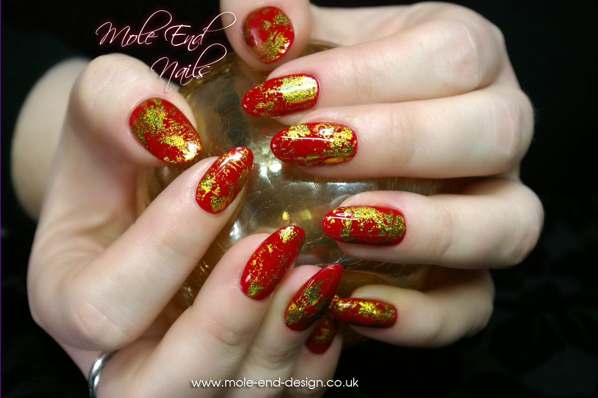 Red gel nails with gold foil accents - Nails, Eyelashes and Eyebrow Treatments