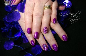 Purple starburst sparkle nails