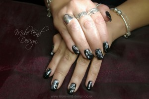 Black nails with filigree