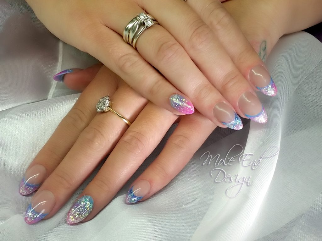 Reverse french acrylics with pink and blue glitters