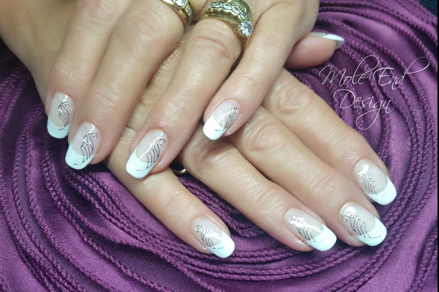 Gel polish french with silver swirls