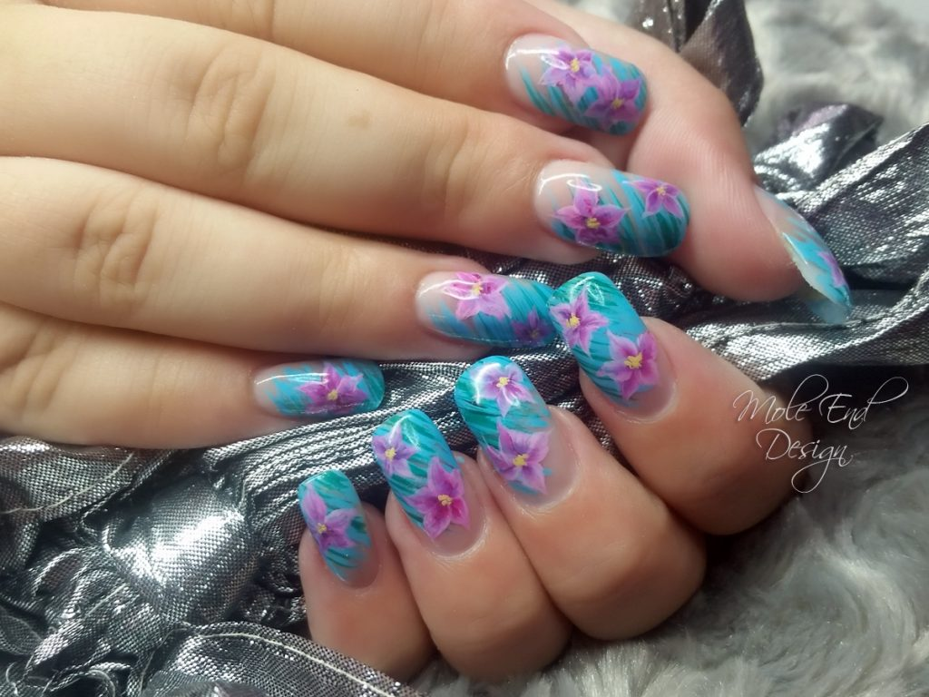 Acrylic extensions, aqua background with pink one stroke