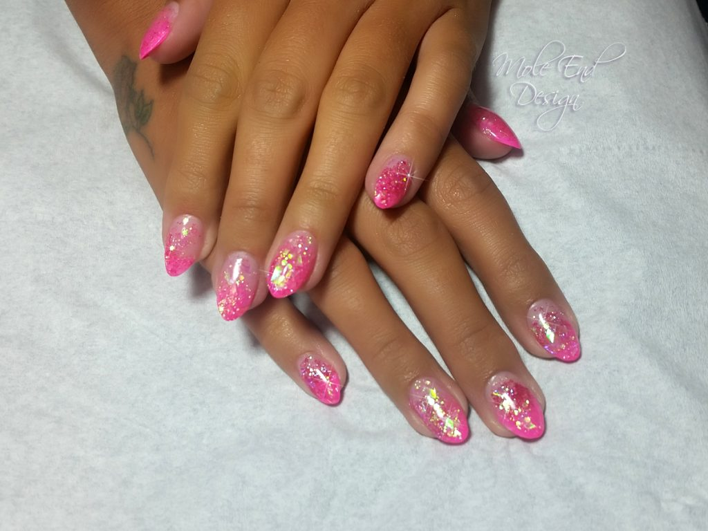 Acrylic extensions with pink and gold sparkles
