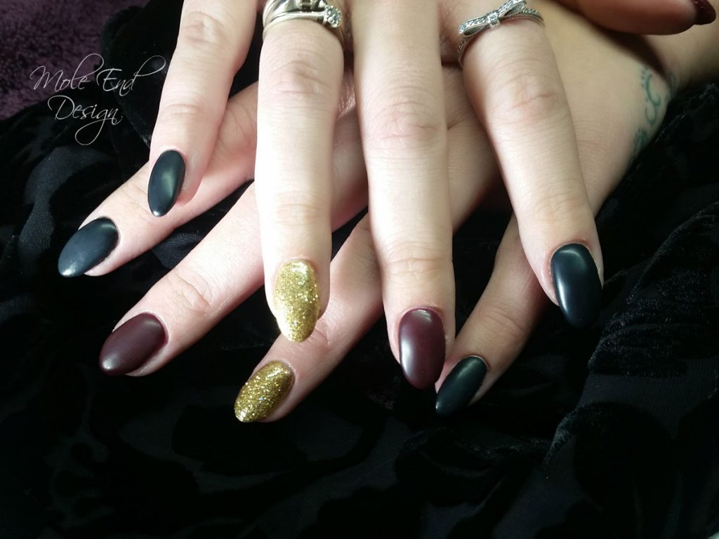 Matte Black, deep red and glitter nails