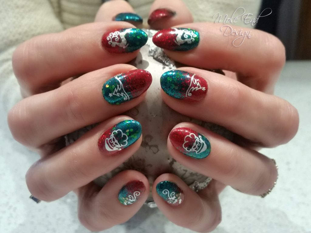 Christmas nails in red and green glitter with stamping