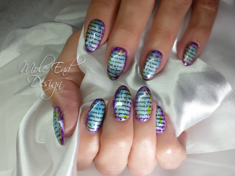 Pigments and stamping over pale blue gel polish