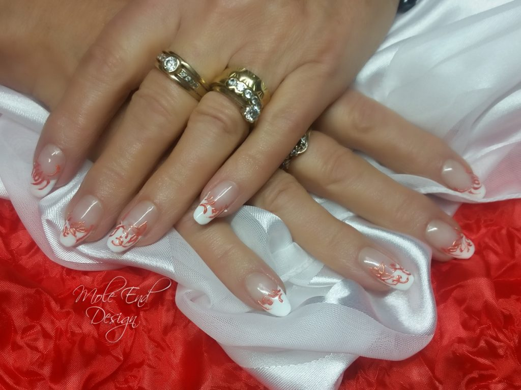 French nails with orange 3d detail
