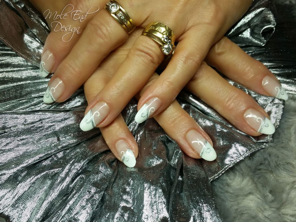 French nails with silver swirl