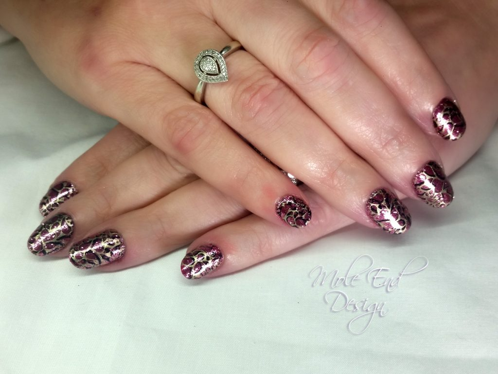 Glitter base with double stamping in black and gold