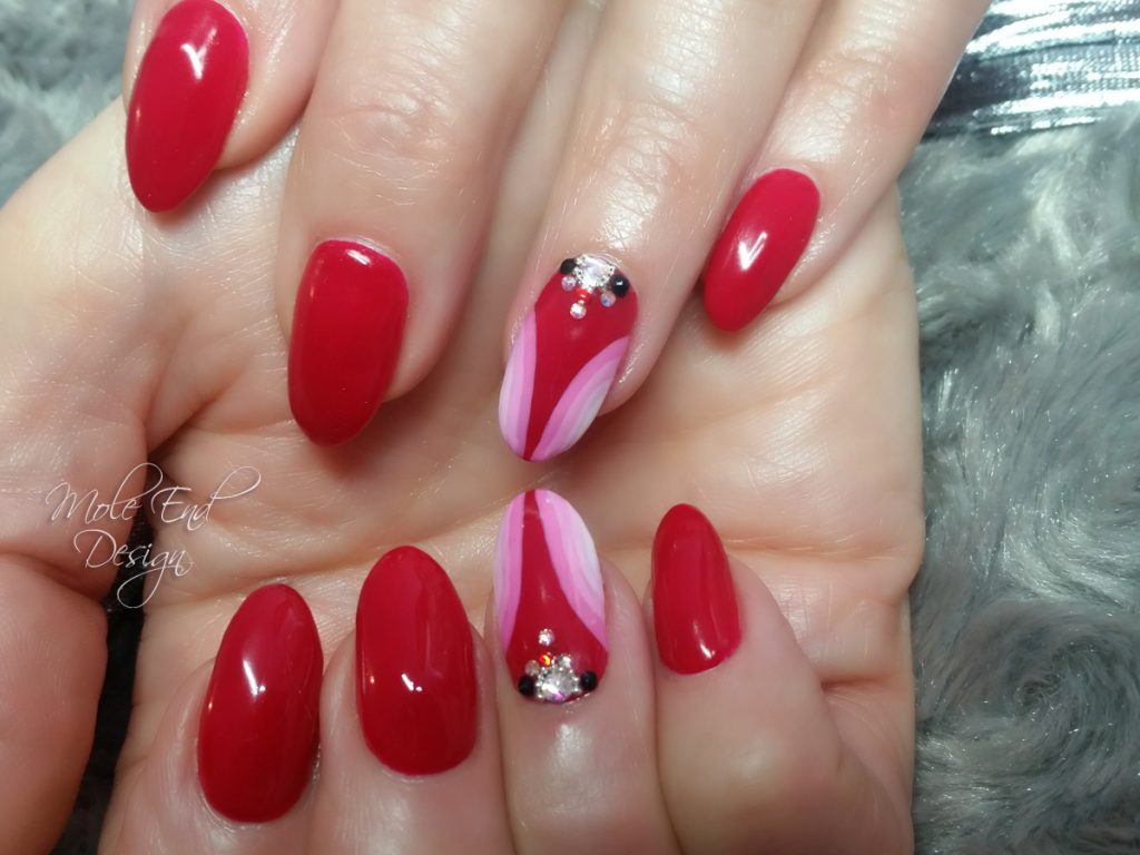 Red geometric with gems