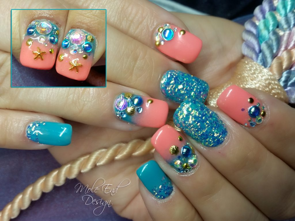 Coral and turquoise seaside themed nails