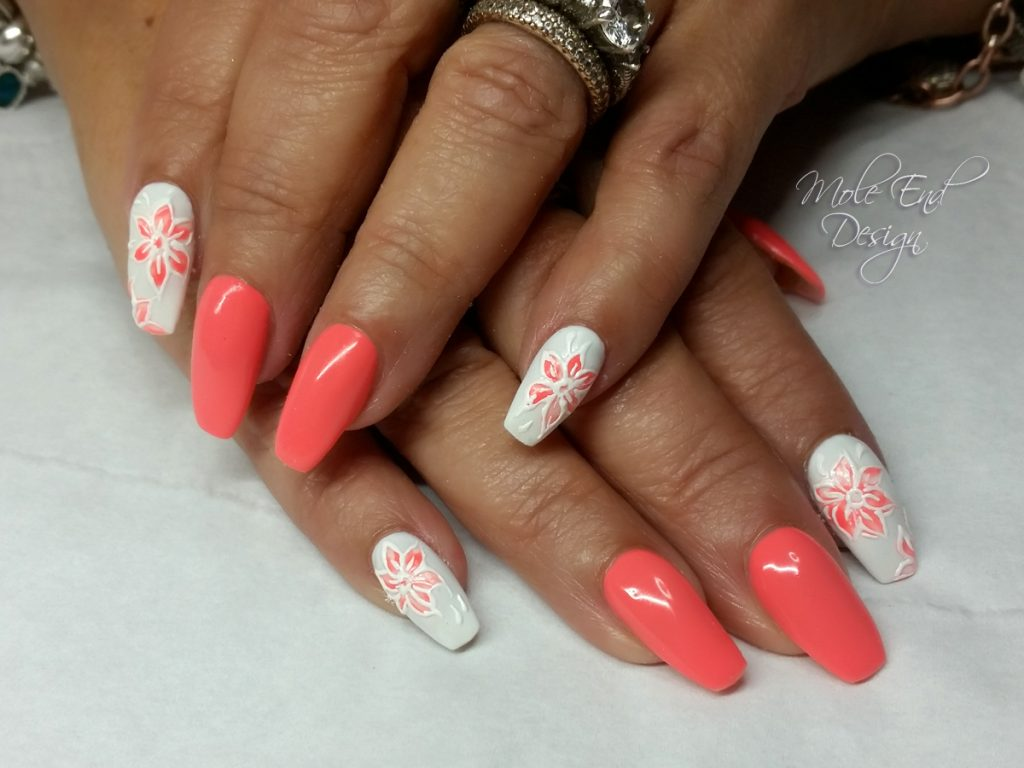 Coral and white nails with flower detail