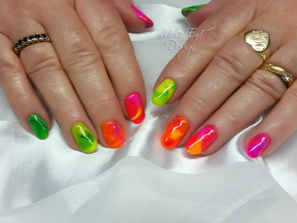 Neon nails with swirls in pigment