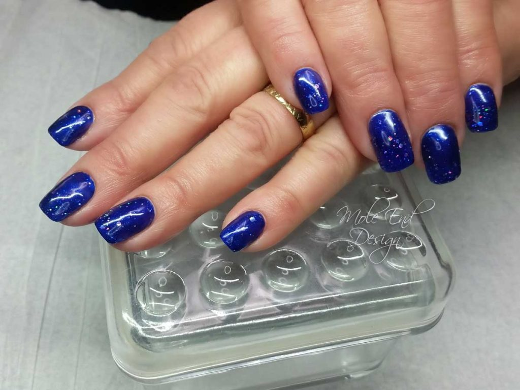 The Gel bottle sparkly blue nails