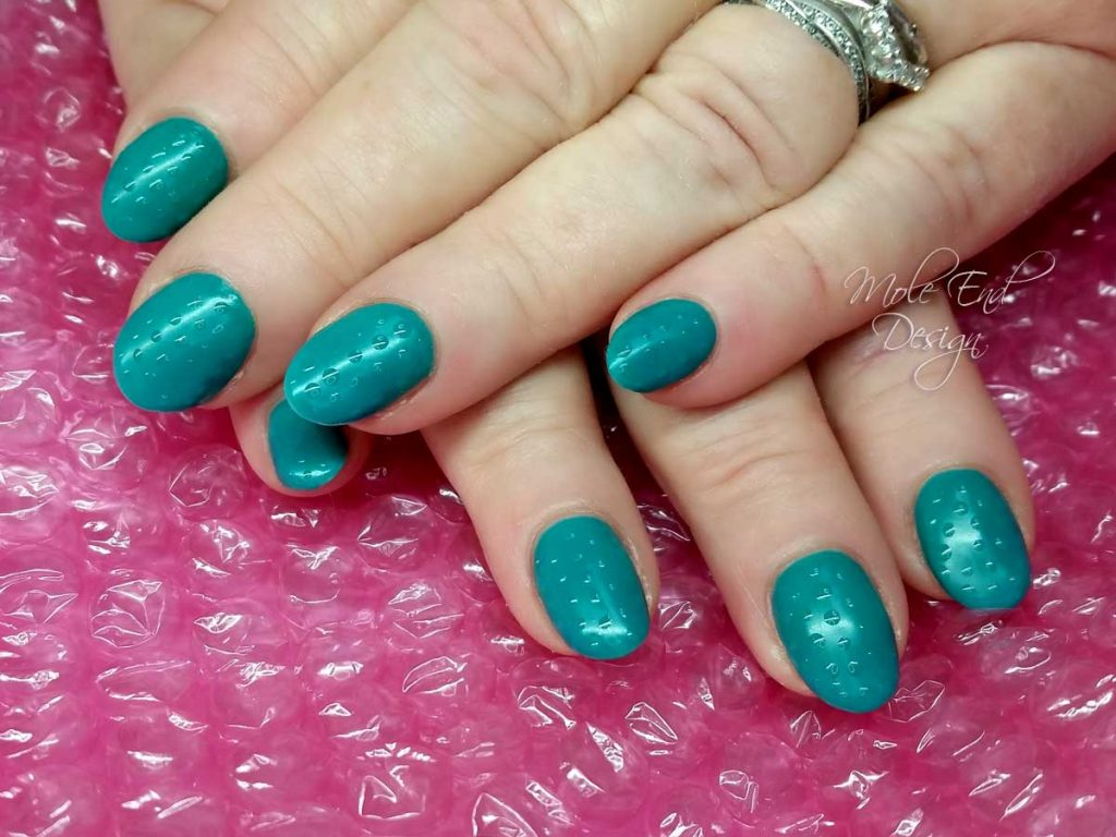 Teal bubble nails