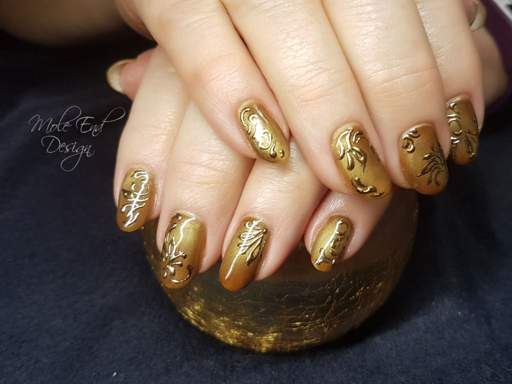 Cat eye caramel with gold foil swirls