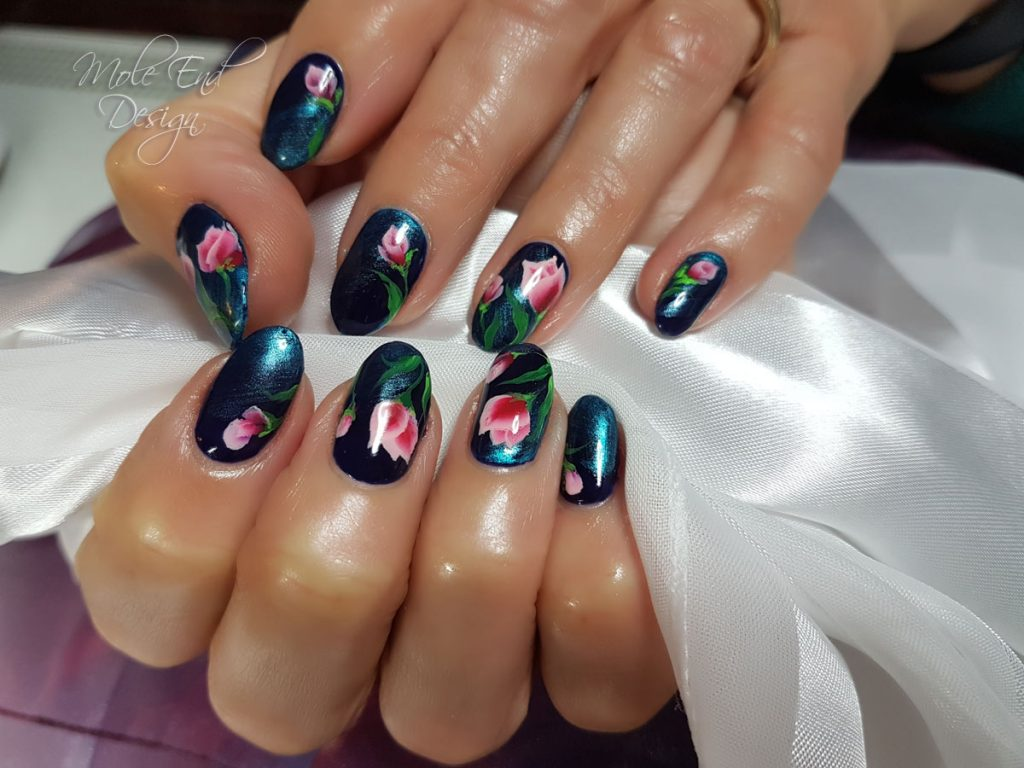 One stroke Tulips over black gel polish burnished with blue