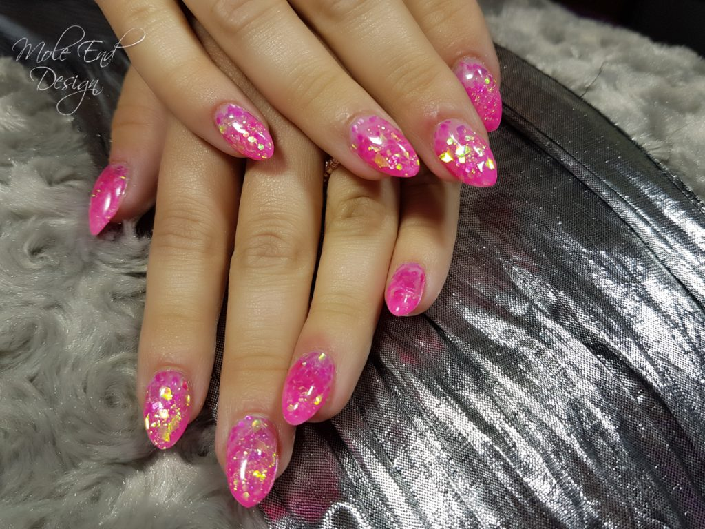 Encapsulated pink and iridescent glitter in acrylic